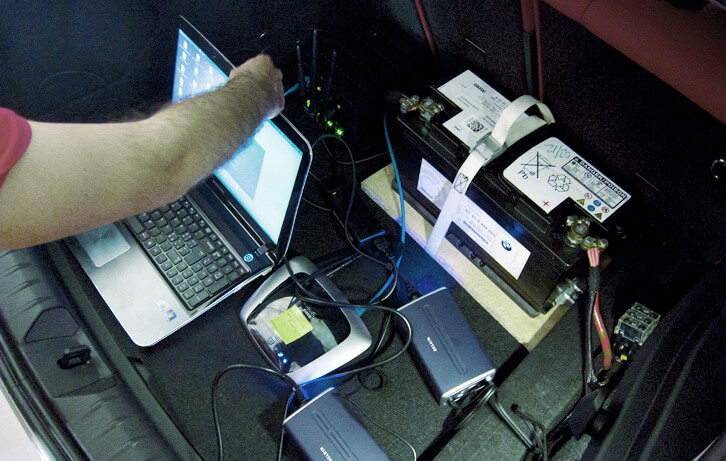 The trunk of the car, showing the server, the power suppliers and the router